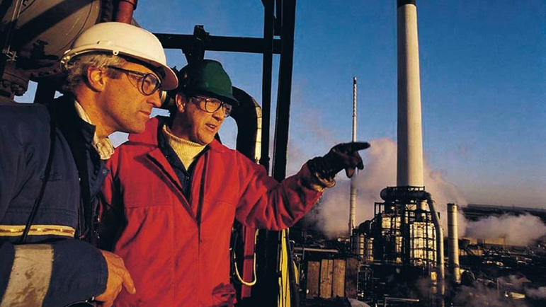 Two people in a industrial plant