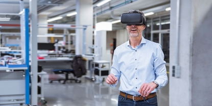 Man in an office with virtual reality glasses